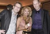 <strong>Susan Thompson holds Emmy Award flanked by Big Brother Co-Creator Paul Romer and Dutch television presenter and chairman of BNN, Patrick Lodiers, at the 36th International Emmy Awards Gala.</strong>