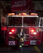 <strong>Paul Mobley photographes Rochelle &quot;Rocky&quot; Jones: New York's first female battalion chief shortly after 9/11.</strong>