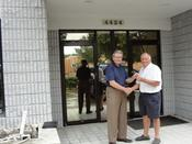 <strong>Tom Wilson from Coldwell Banker Commercial handing over the keys to Bob Page CEO of Tarpaflex Us Llc to their new office/warehouse at 4424 Corporate Square, Naples, Florida.</strong>