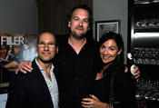 <strong>Kevin Hill with wife Tricia Hill and Producer Mark Ordesky at a cocktail party at the Toronto Film Festival.</strong>