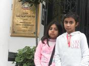 <strong>Daughters of Safi Qurashi stand outside UAE Embassy in London with little hope.</strong>