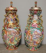 <strong>Pair of Important Chinese Porcelain Lidded Urns. Enamel painted with scenes of daily activities. Applied painted and gilded flowers and leaves.</strong>