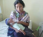 <strong>A mother with her sick baby at Hospitalito Atitl�n.</strong>