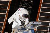 <strong>NASA astronaut Andrew Feustel, STS-134 mission specialist, installs the Materials on International Space Station Experiment - 8, or MISSE-8, hardware attaching it to the outside of the ISS. (NASA)</strong>