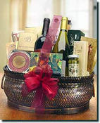 Champagne or wine is combined with gourmet foods to create a stunning basket. These and other Same Day Delivery gifts available at Arttowngifts.com
