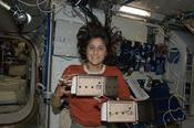 <strong>Astronaut Suni Williams with the YouTube SpaceLab payload Spider Habitat where Nefertiti the spidernaut lived while she was on orbit. (Credit: NASA)</strong>