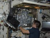 <strong>JAXA astronaut Akihiko Hoshide, Expedition 33 flight engineer, works on the Multipurpose Small Payload Rack in preparation for the arrival of the Medaka Osteoclast payload on Oct. 25. (NASA)</strong>