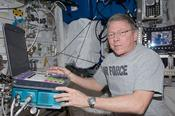 Expedition 29 Commander Mike Fossum is photographed working with the USND-2 (Ultrasound 2) unit in front of the HRF-1 (Human Research Facility 1) Rack. (NASA)