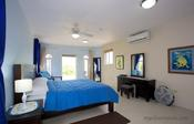 <strong>The master bedroom at Mi Amor Villa in Silver Sands Jamaica is furnished with a king size bed.</strong>