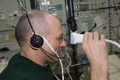 <strong>Astronaut Don Pettit performs ultrasound eye imaging during Expedition 30. Diagnostic ultrasound in microgravity is one of the many topics students researched for the ISS Science Challenge. (NASA))</strong>