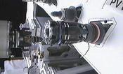 "Stray drops of ethanol remain on the RRM Nozzle Tool after it withdraws from the fuel valve and the newly attached ""quick disconnect"" fitting. (NASA))"