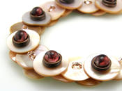 <strong>Mother of Pearl Button Necklaces, handmade. We can make a variety of necklaces in various colors. We also offer lightweight Wood button necklaces.</strong>