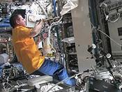 <strong>Expedition 34 Commander Kevin Ford works with the Materials Science Laboratory's Solidification and Quenching Furnace, located in the Material Science Research Rack aboard the ISS. (NASA TV)</strong>