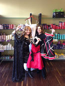 <strong>Elle Marie Alderwood Salon Manager Hollie Leach and Studio Coordinator Brooke Undseth show a number of evening gowns.</strong>