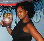 <strong>Stephanie Acon holds a copy of her first novel, &quot;Escape from a Nightmare.&quot;</strong>