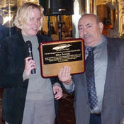 <strong>Lori Scharff of the Long Island Council of the Blind presents MaxiAids' President and Founder Elliot Zaretsky a plaque recognizing his contributions to the blind and low vision community</strong>