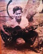 <strong>George Jones First Guitar, here George poses with his very first guitar, A Gene Autry Cowboy Guitar. This picture was taken in the early 1940's in Saratoga, TX</strong>