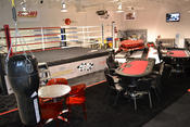 <strong>Kwan International at the Las Vegas Motor Speedway is the setting for Project All In. A drag boat and multiple poker tables and flat screens sit throughout the facility.</strong>