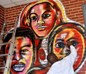 <strong>Atlanta-based artist Corey Barksdale was commissioned to paint a mural for the International Community School in Decatur, Georgia. Twenty-five languages are spoken in the homes of ICS students.</strong>