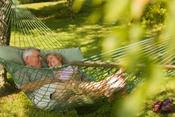 <strong>A couple relaxing in a hammock at Inn and Spa at Cedar Falls.</strong>