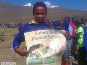 <strong>Boy in Lesotho with poster</strong>