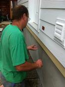 <strong>Installing the Hidden-Vent on Duraskirt mobile home skirting panels.</strong>