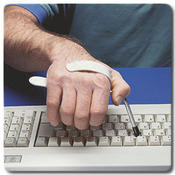 <strong>A computer keyboard assist helps keyboard stroke control for accuracy of writing.</strong>