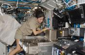<strong>NASA astronaut Nicole Stott installs hardware in the Fluids Integrated Rack (FIR) in the Destiny laboratory of the International Space Station during Expedition 21. Image Credit: NASA</strong>