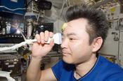 <strong>Expedition 33 flight engineer Akihiko Hoshide of the Japan Aerospace Exploration Agency performs ultrasound eye imaging on the International Space Station. Image Credit: NASA</strong>