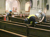 <strong>The Keck Group's crew removing pews from St. Patrick's Cathedral.</strong>