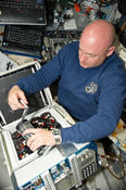 <strong>View of STS-134 Commander Mark Kelly working with Group Activation Pack (GAP) assemblies on the shuttle Flight Deck. Image Credit: NASA</strong>