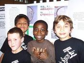 <strong>East Lyme, Conn.: 5th graders Noah, Brandon, Makaih, and Nick are feeling confident after facing the SSEP Step 1 Review Board at East Lyme's Race to Space Night. Image Credit: SSEP</strong>