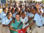 <strong>Greg Anderson, director of the Crown Council, providing dental care to children in the Dominican Republic.</strong>