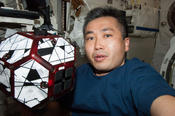 <strong>JAXA astronaut Koichi Wakata conducts a session with a pair of bowling-ball-sized free-flying satellites known as SPHERES aboard the International Space Station. Image Credit: NASA</strong>