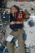 <strong>NASA astronaut Mike Fossum puts one of the Smart SPHERES through its paces after addition of the smartphone to turn the SPHERES into mobile data acquisition assistants. Image Credit: NASA</strong>