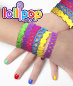 <strong>Close-up of happy hands wearing Lollipop Bandz bracelets.</strong>