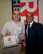 <strong>Feedvisor CEO Victor Rosenman accepting the Red Herring Top 100 Europe award</strong>