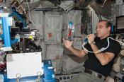 <strong>Rick Mastracchio conducting a Capillary Flow Experiment aboard the International Space Station. Image Credit: NASA</strong>