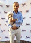 <strong>Alex Daszkal, Founding Partner, Goldman & Daszkal, P.A., with his grand-dog, Heidi, at the PROPEL Fine Wines and Canines Event</strong>