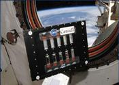BCAT-5 Slow Growth Sample Module in a window of the International Space Station. Image Credit: NASA/CSA