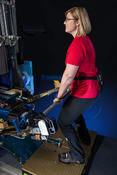 <strong>Andrea Hanson, Ph.D. and ISS Exercise Hardware Specialist, demonstrates the use of the ForceShoe on the Advanced Resistive Exercise Device. Photo credit: NASA</strong>