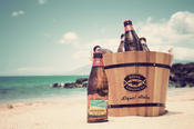 <strong>Longboard Island Lager chilling on the beach in an ice bucket</strong>