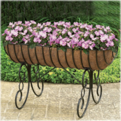 <strong>Planters of various heights add interest to a patio or deck area.</strong>