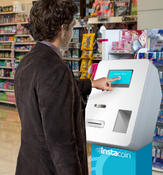 <strong>Buying Bitcoin with cash at an Instacoin machine.</strong>