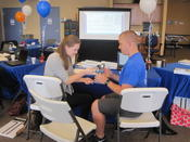 <strong>Brett Jensen, ATC/L practices grip strength tests with Lauren Geier, ATC.</strong>