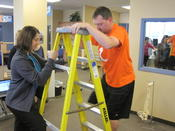 <strong>Tracy Benson, MOT, OTR/L, CHT and Matt Winans, LAT practice functional testing for ladder climbing tasks.</strong>