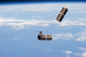 <strong>Two of the 28 Planet Labs Dove satellites that make up the Flock 1 constellation are seen launching into orbit earlier this year from the International Space Station. Image Credit: NASA</strong>