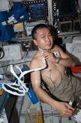 <strong>JAXA astronaut Koichi Wakata, Expedition 38 Flight Engineer, demonstrates the ultrasound used to collect data for the Cardio Ox investigation, in the Columbus Module. Image Credit: NASA</strong>
