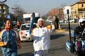 <strong>Klaus Veile running with the Olympic Torch in Turin, Italy in 2006.</strong>