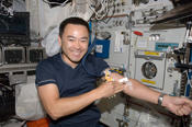 <strong>Japan Aerospace Exploration Agency astronaut Akihiko Hoshide poses for a photo after undergoing a generic blood draw aboard the International Space Station. Photo credit: NASA</strong>